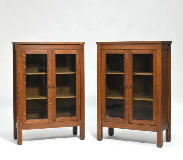 """Pair of diminutive Mission Oak bookcases with double glass doors, good finish, 24"""" W X 36"""" H X 11"""" D. Condition both very good with no loss or damage, minor nicks to edge, top with some minor stains."""