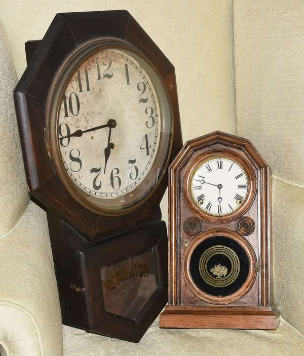 """Two antique clocks: Sessions Clock Co., CT. regulator wall clock, 26""""H x 16.5""""W; with an E. Ingraham & Co., CT, mantle clock with eglomise panel, 15.5""""H x 8""""W. Condition: Ingraham with paper dial currently over original dial. Damage to face of Sessions."""