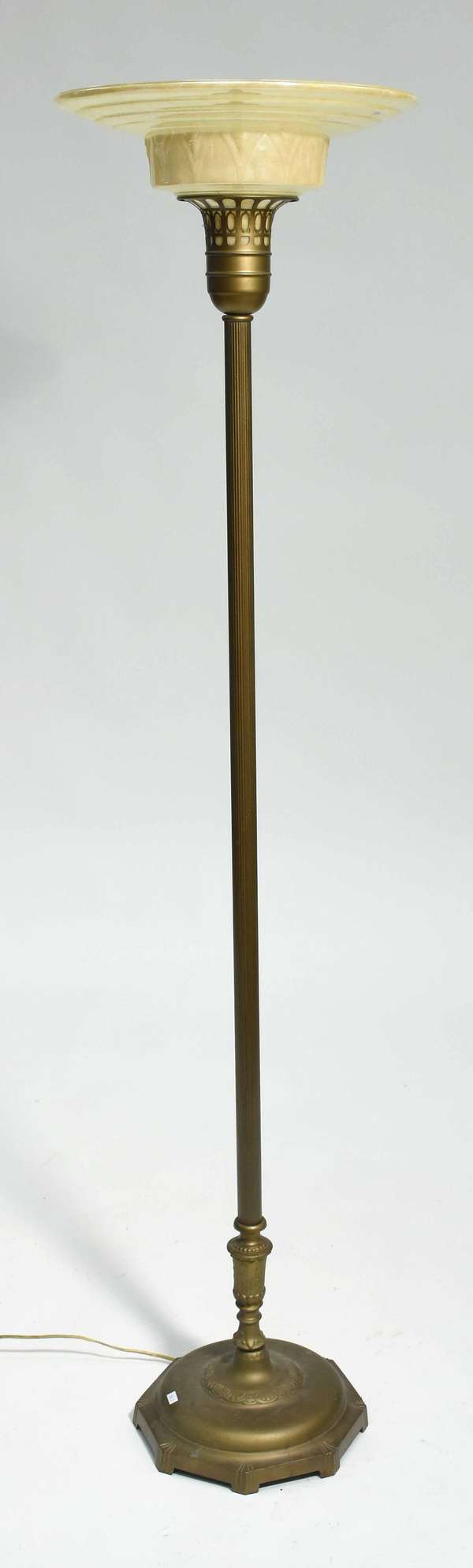 """Art Deco floor lamp with iron base and yellow metallic glass shade, 65""""H x 16"""" dia. Condition: shade with chipping to lower rim, not visible when mounted"""