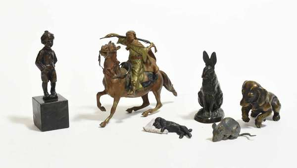 """Group of six small bronze animals and figurines, including a bronze rabbit signed Bayre, and F. Barbedienne on base, 3""""H x 2""""W; Arabic horse and rider, signed Bergman, 5.25""""W x 4.5""""H; boy with cigarette, 4""""H, along with other dog, mouse, and dog on pillow figures. Condition: leg of horse and arms of man bent"""