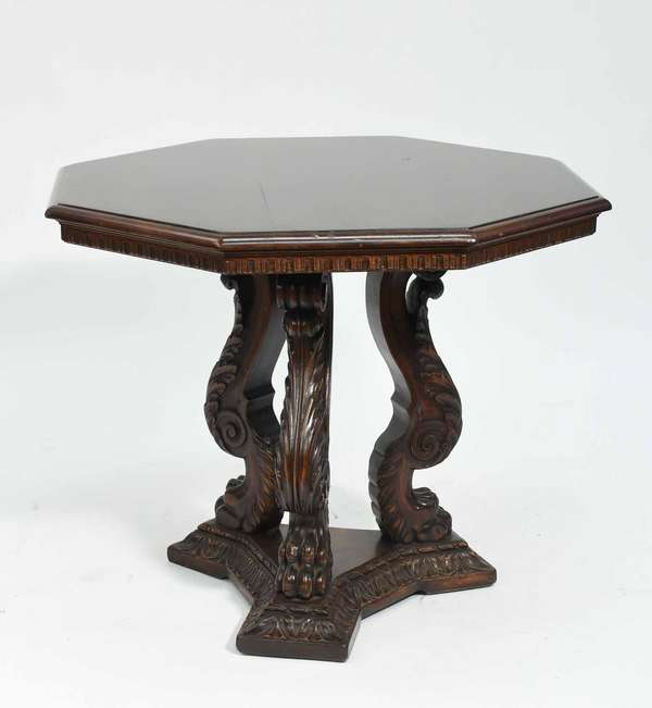 """Carved 20th C. Classical style mahogany Shaw Furniture Co. center table, octagonal top with well carved tri-legged paw-foot supports on carved base, dentil molded apron, 30""""H x 35"""" dia.. Condition: some scuffing"""