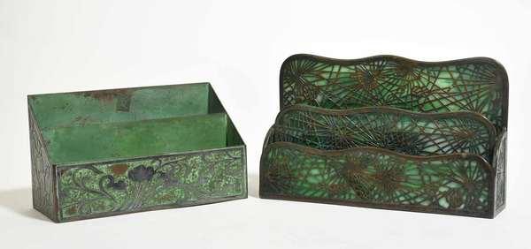 "Two Art Nouveau letter holders: Tiffany Studios bronze and green slag glass letter holder, pine needle pattern, two-tier, 10""L x 6""H, with a verdigris copper with silver overlay letter holder, two tier, floral design, 8.5""L x 5""H. Condition: slag glass panels broken"