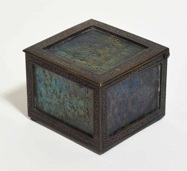 """Bronze box with hinged lid and five dark  iridescent favrile art glass panels. 4.75""""W x 4.75""""L x 3.75""""H. Condition: good overall"""