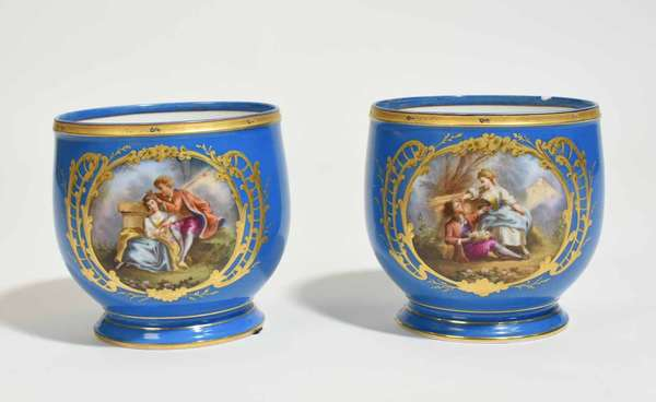 """Pair of Sévres Bleu Celeste jardineres, with gilding and hand painted courting scenes, 6.5""""H x 6.5"""" dia. Condition: chip to rim of one"""