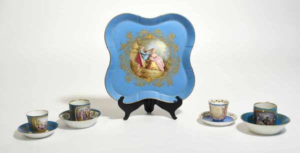 """19th C. Bleu Celeste four lobed porcelain tray with hands painted center roundel, 11.75""""L x 11.75""""W, with four Sévres cups and saucers, various patterns. Condition: very good, tray with some wear to center gilding, two saucers with gilding wear"""