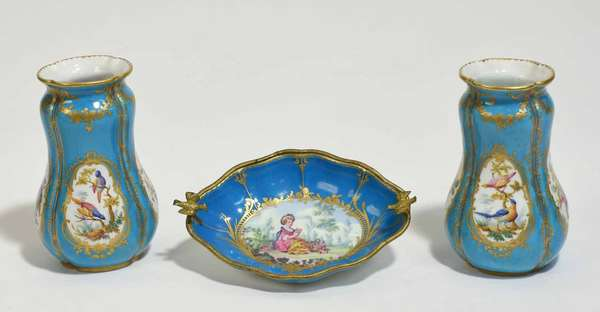 """Three pieces of Sévres porcelain, including a pair of Bleu Celeste vases, 6""""H, with a ormolu mounted dish with shaped edge, flying bird handles, 8"""" x 5.5""""W. Condition: ormolu mount lifting"""
