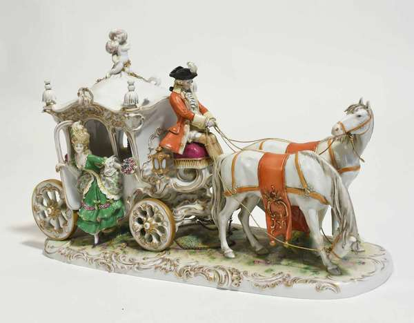 """Large Sitzendorf German porcelain figural group, horse and carriage sculpture, with elegant women exiting carriage, signed on bottom, 17.75""""L x 12""""H x 6.5""""D. Condition: one ear on each horse with losses"""