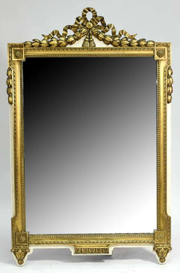 """Large late 19th C. to early 20th C. Italian neoclassical gilded wood wall mirror  with corner rosettes and ribbon top crest, 43.25""""W x 69.5""""H Condition; loss to upper left corner overall scuffing"""