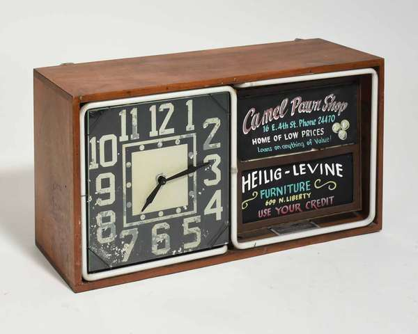 """Antique revolving ad clock, made by Electric Ad Clock Co, Chicago. 12""""H x 23.5""""L x 6.75""""D. Condition: paint loss to dial"""
