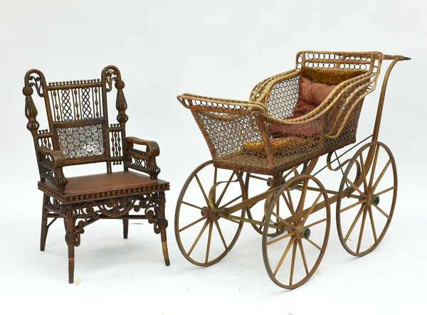 """Elaborate Victorian Wicker chair 20""""W x 34.5""""H x 15.75 seat height; with a Victorian wicker pram 52""""L x 26""""W x 37.5""""H Condition; carriage with breakage to wicker on sides, chair with breakages to seat back and arms losses to right front leg decoration"""