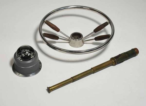"""Three piece of nautical lot: modern ships wheel, 17"""" dia., antique brass and leather telescope, 22.5"""" extended, and a ship's compass, 6""""H. Condition: losses to leather on telescope"""