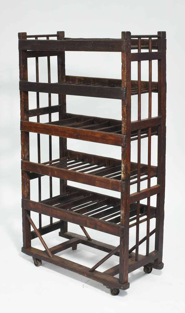 """Antique wooden five tier industrial shoe rack on castors, 30""""W x 55.5""""H x 15""""D Condition; overall wear, slightly rickety"""