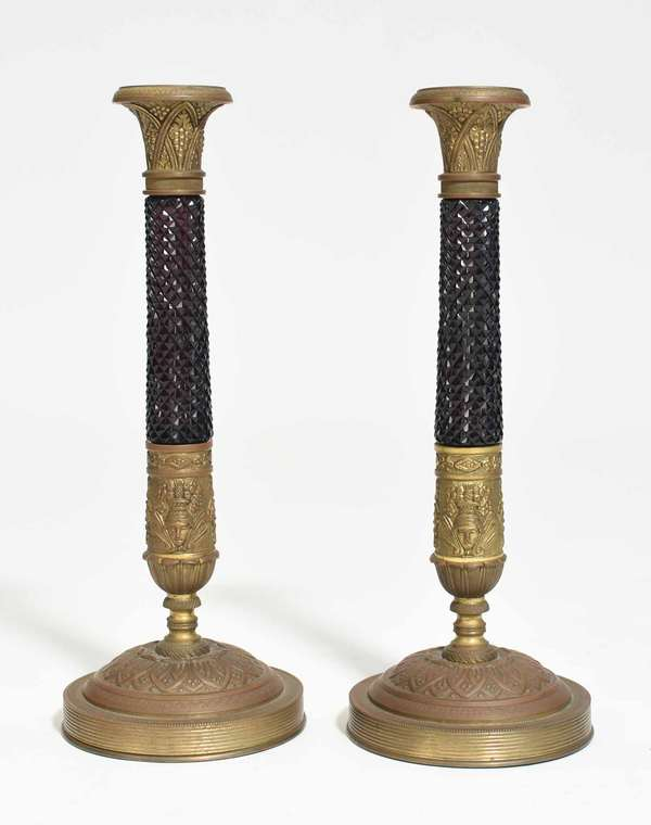 """Pair of French Empire bronze and amethyst glass candlesticks, with Classical decoration, 12""""H. Condition: looks to have been electrified at one point, filled holes."""