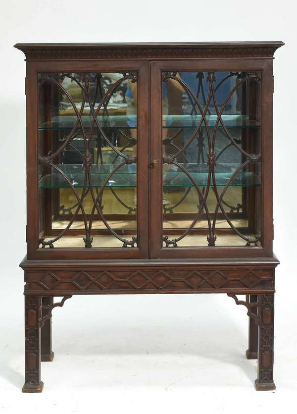 """Aimone Mfg. Co. Mahogany china cabinet, with label on reverse, stamped 4581, one carved legs with Two carved lattice work glass doors. 38""""W x 50""""H x 19""""D. Condition: with key, some regluing to front legs"""