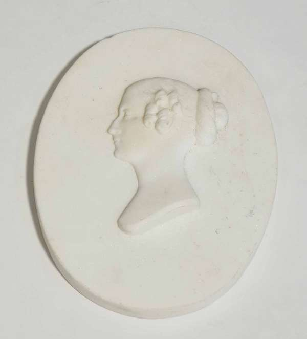 """19th C. carved oval marble plaque with bust portrait of young woman, inscribed on back , Alph. Giroux, Paris. 9.75""""L x 5.5""""W. Condition: three chips to edges"""