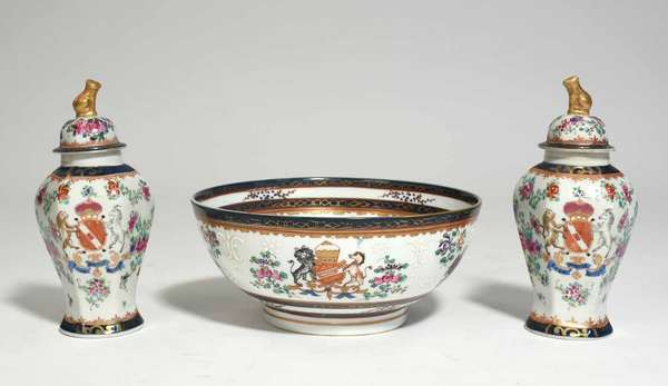 """Three piece set of Samson porcelain, including a larger center bowl, 9.75"""" dia. X 4.75'H, and a pair of lidded urns with gilded lion finials, 8.75""""H. All with coat of arms decoration. Condition: one chip to inside rim of lid"""