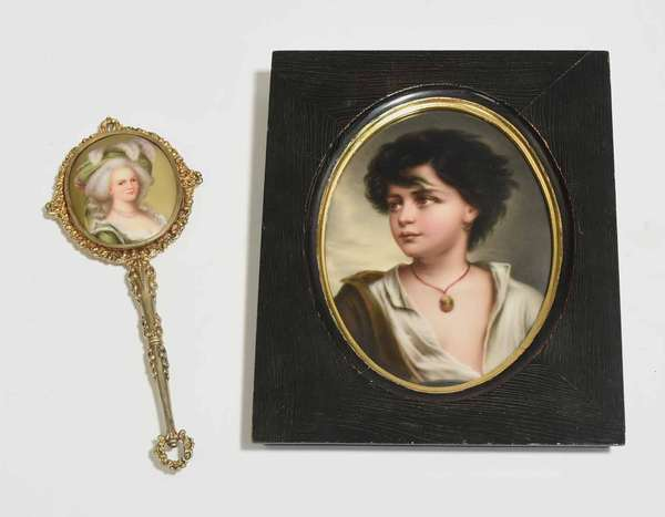 """19th C. German oval hand painted porcelain plaque in frame, of a boy with necklace, plaque 6.5"""" x 4.5"""", frame 8"""" x 6.5""""; along with a sterling vermeil hand mirror with painted porcelain plaque of an elegant 18th C. lady, 7.5""""L overall. Condition: mirror aged and flaking. Plaque with three small scratches in hair"""