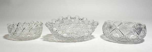 """Three antique cut glass bowls, oblong bowl, 12.5""""L x 7.5""""W, with other, 8""""W x 3""""H and salad bowl 9""""W x 3.5""""H. Condition: chipping to edges"""