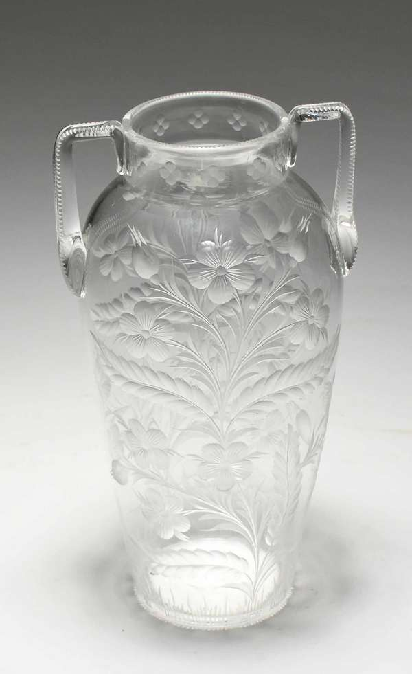"""Tuthill cut glass handled vase, signed on bottom, with floral design. 10""""H x 5.5""""W. Condition: signature worn. No chips or cracks, scratching to bottom"""