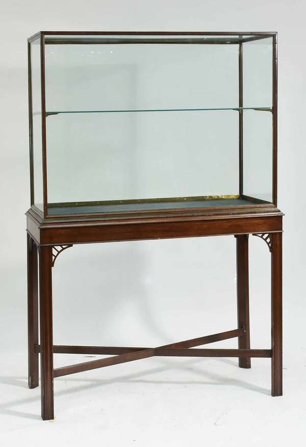 """Good bronze and glass display case on wooden cross stretcher base, back with sliding door, one glass shelf. 70""""H overall, 44""""W x 17""""D. Condition: overall good, base with some scuffing"""