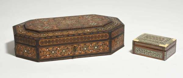 """Two Anglo Indian inlaid wooden boxes with mother-of-pearl and other woods, larger example eight sided with inlaid inside lid, sewing contents, and key, 14.25""""L x 8.5""""W, and smaller example 4.75""""L x 3.25""""W. Condition: losses to inlay around base of larger box"""