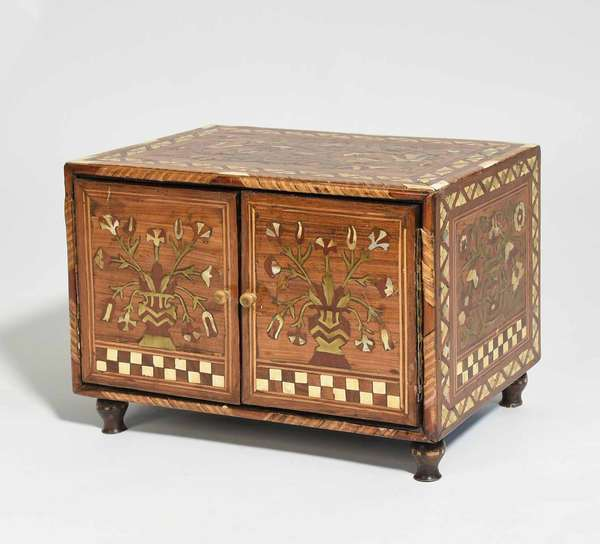 """Anglo Indian tabletop cabinet with doors doors opening to reveal thirteen inner drawers. With metal, mother-other-pearl and wood inlays. 14.5""""L x 9.5""""W x 11.25""""H. Condition: two pieces of missing inlay on side"""