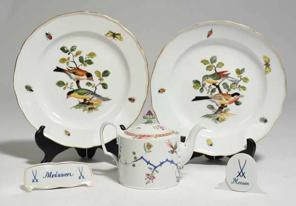 """Lot of Meissen porcelain including two plates with bird and beetle decoration, 9.5"""" dia; a Meissen Marcolini Kakiemon teapot, 7""""W x 4.75""""H, and two Meissen display placards, 4.25""""L and 2.25""""H. Condition: plates with wear to rim gilding, one with slight wear to leaves"""
