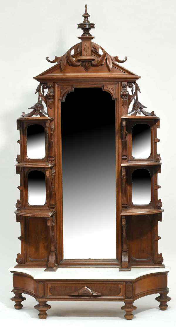 19th C. carved two-part Victorian walnut mirrored back etagere with white marble base.Condition: three small chips to front and left side edge of marble. Areas of regluing. Loss to carving in upper right hand corner, also to bracket below middle shelf on left side
