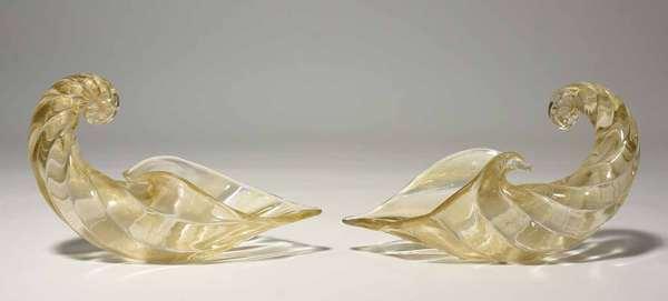 "Pair of gold-flecked art glass cornucopia centerpieces, signed Venini (Murano, Italy), 13""L x 9""H. Condition: very good."