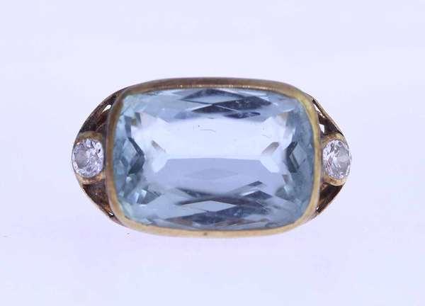 Ladies aquamarine and diamond ring, rectangular aqua with two side diamonds, tests 14k sz 7.5. Condition: good.