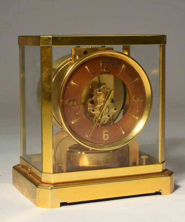 """Early Le Couture Atmos clock #59602. 9.25""""H x 8.5""""W. Condition: flaking and scratching to dial, minor pitting to base."""