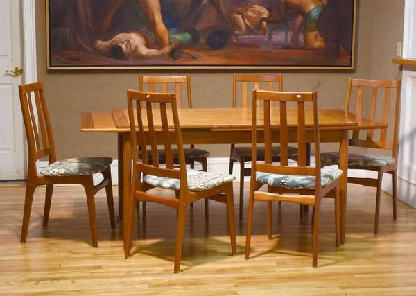 """Mid-Century teak dining set, including draw-leaf table, and six matching chairs with upholstered seats. No apparent makers mark. Table 55.5""""L closed, 98.5"""" extended, 35.5""""W x 29.5""""H. Chairs 38""""H overall, seat height 18""""H. Condition: some chairs slightly wobbly."""