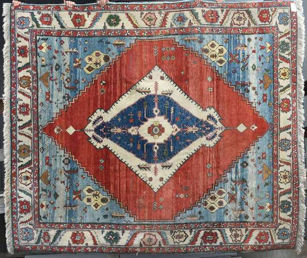 """Oriental room size rug, Turkish Serapi style, with brick, ivory and blue ground, with center medallion, with label, 10'6"""" x 9'1"""". Condition: areas of staining, needs clean. Minor edge wear"""