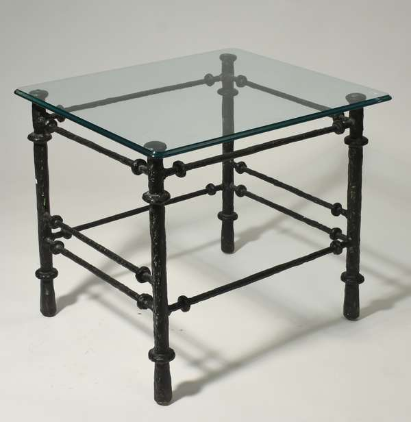 """Brutalist style cast metal end table with plate glass top and unique stretchers. 23""""W x 27""""L x 25""""H. Condition: good."""