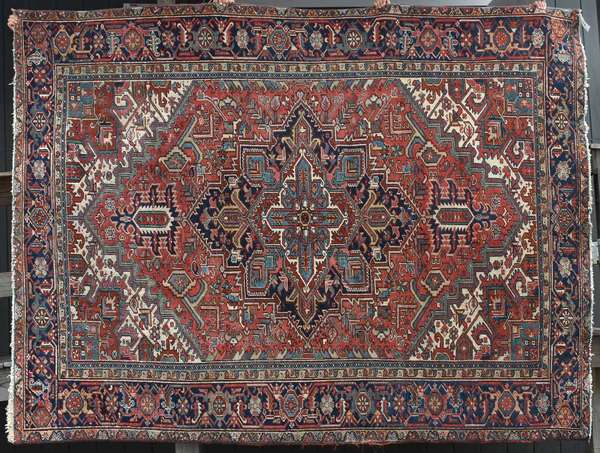 Antique Oriental Heriz rug, 8'x11'. Condition: overall wear, edge fraying.