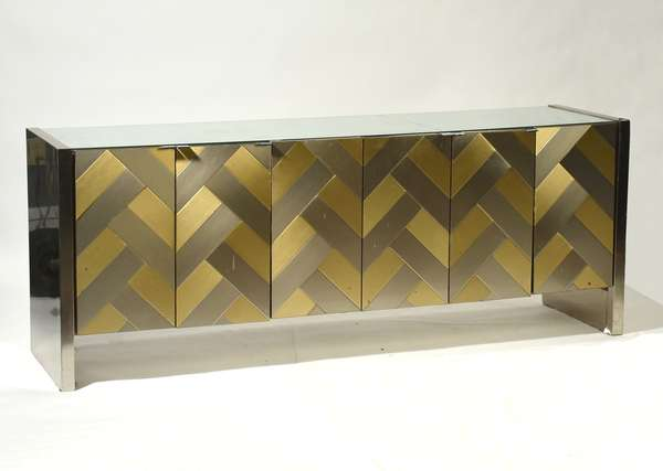"""Ello mirrored credenza with six panel doors, stainless and brass herringbone design, stainless sides, mirrored top, 75.5"""" x 20.5"""" x 29.5"""". Condition: cracked mirror top, loss on interior far left door surface abrasions and denting throughout."""