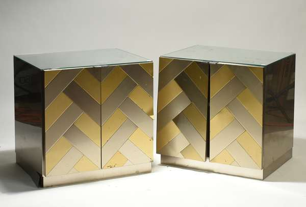 """Pair of Ello mirrored side cabinets, with stainless and brass herringbone design, stainless sides, and mirrored top, 24.5""""W x 20.5""""D x 25""""H. Condition: lifting to veneer throughout, chipping to all corners of mirrored top, one drawer does not sit flat"""