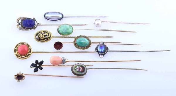 Lot of thirteen stick pins: seven test gold including one coral with diamonds. Condition: good.