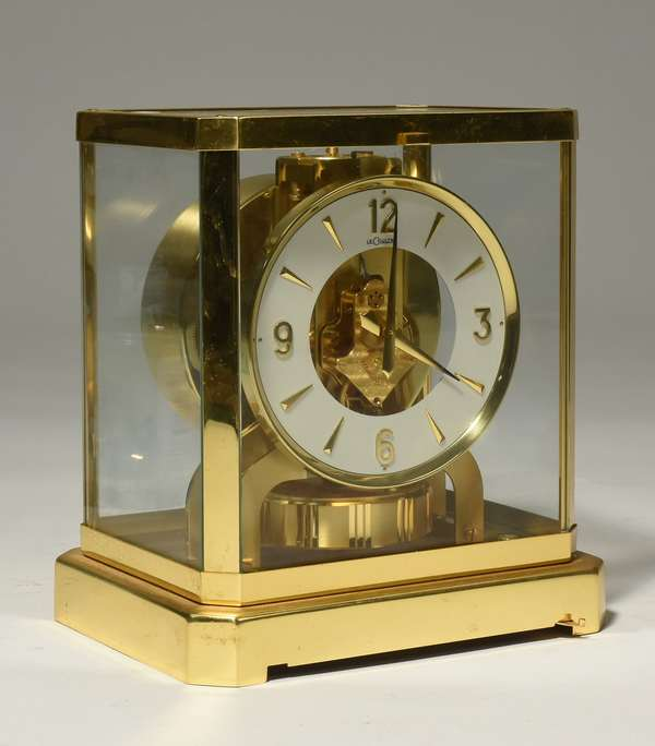 """Le Coultre Atmos brass and glass shelf clock, no. 280596. 9.5""""H. Condition: minor surface scratches."""
