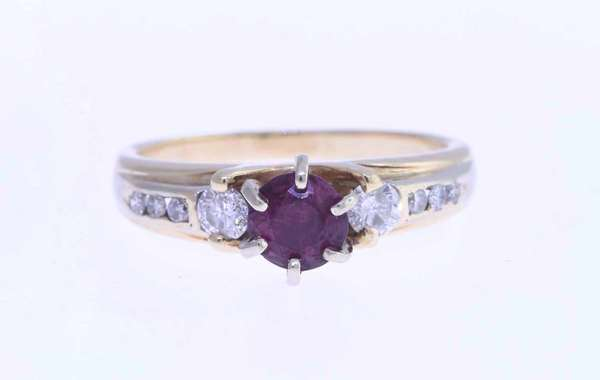 14K ruby and diamond ring, set with center ruby flanked by two side diamonds and six accent diamonds, size 9.25. Condition: good.