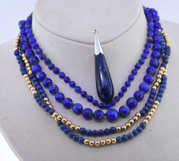 Three pieces of lapis lazuli jewelry: 14K gold and lapis bead necklace, graduated lapis bead necklace and lapis teardrop pendant. Condition: good.