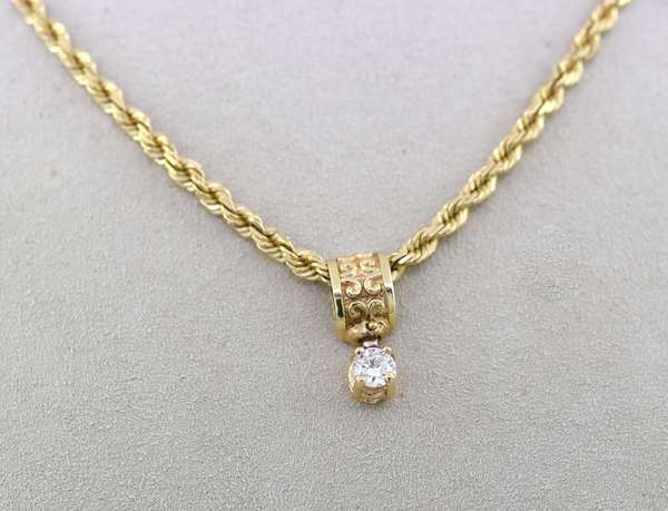 14K rope chain with diamond pendant, approx. 1/3 ct, 15 grams. Condition: good.
