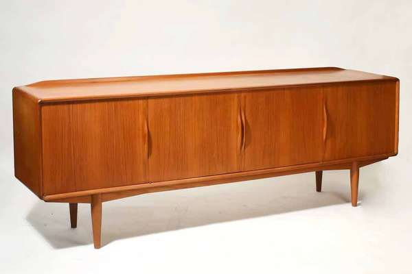 """Gustav Bahus  Norwegian teak sideboard, with four doors, left side with flatware drawers inside, stamped on reverse. 88""""L. x 31""""H. x 17.5""""D. Condition: ring stain to top surface."""
