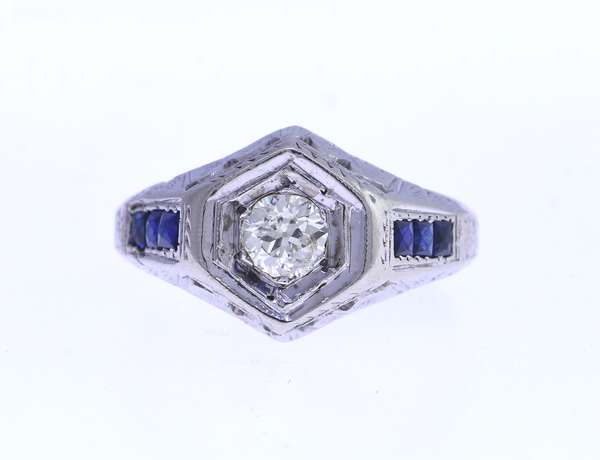 14K white gold and diamond ring, set with approx. .50 ct diamond, and six sapphire baguettes, size 7.25. Condition: good.