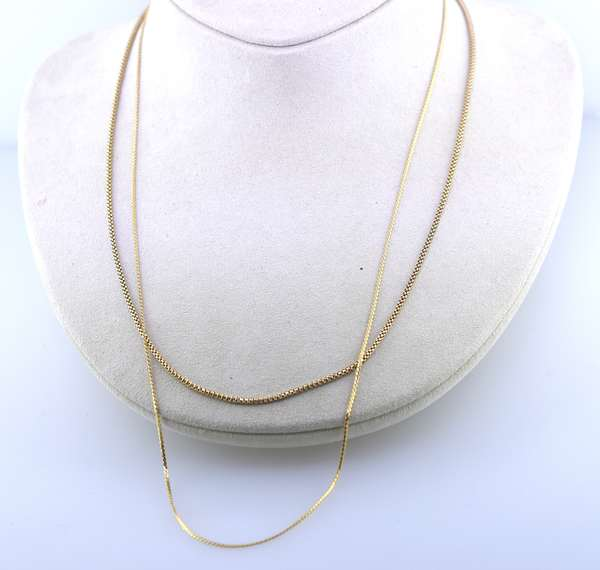 """Two gold chains: 14K example, 17""""L. and 18K example. 6 grams total. Condition: good."""