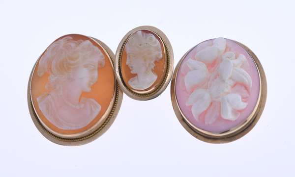 14K shell cameo lot, including two pins and one earring. Condition: good.