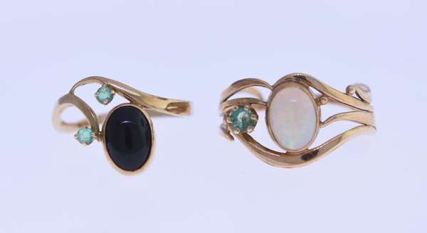 Two 14K custom made gold rings by Gail Lyman; one with opal/emerald, other with a black coral/emerald. Condition: good.