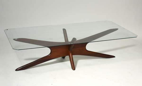 """Adrian Pearsall """"Jacks"""" elongated walnut cocktail table, with glass top. Base: 60"""" x 20"""" x 15.5"""". Glass 57""""L x 27.5""""W. Condition: glass replaced."""