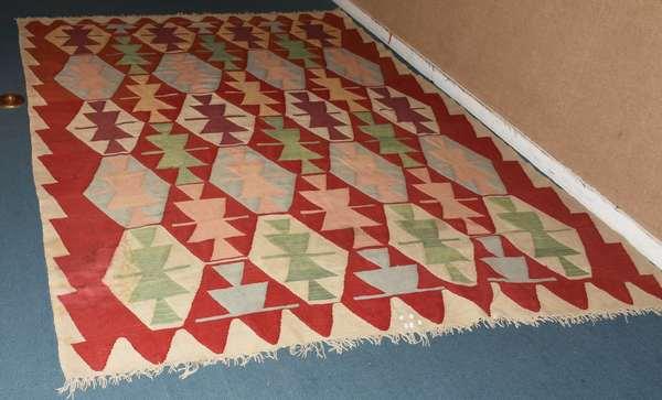 Handmade Ushak Turkish Kilim rug, 9' x 12'. Condition: water stain on corner, other minor stains