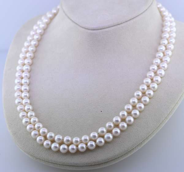 """Double strand cultured pearl necklace, approx. 6.5 mm with 14K circular clasp, 16""""/17""""L. Condition: good."""